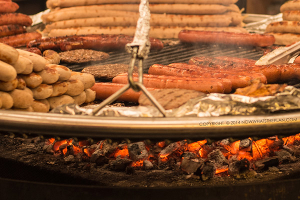 image of Bavarian style sausages being cooked on a swing grill at Winter Wonderland Stoke